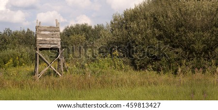 Website banner of a hunting tower in the field  - stock photo