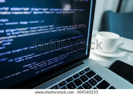 Website Coding. Website HTML Code on the Laptop Display Closeup Photo. Webdesigner Workstation. - stock photo