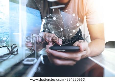 Website designer working digital tablet and smart phone and digital design diagram on wooden desk as concept   - stock photo