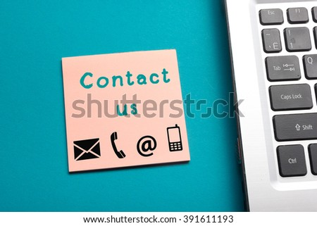 Website, Internet contact us page concept with laptop and reminder - stock photo