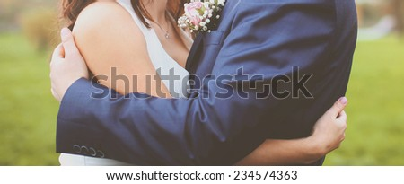 Wedding abstract couple bride and groom embracing outdoors - stock photo