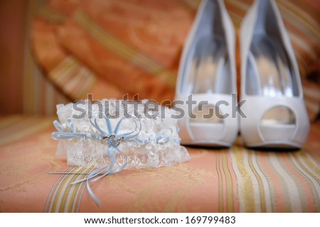 wedding accessories and bridal shoes on the table - stock photo
