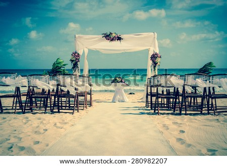 Wedding altar on the beach in Mexico with caribbean sea in the background - stock photo