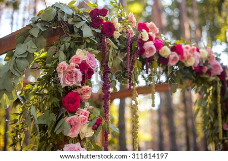 wedding  arch in green forest - stock photo
