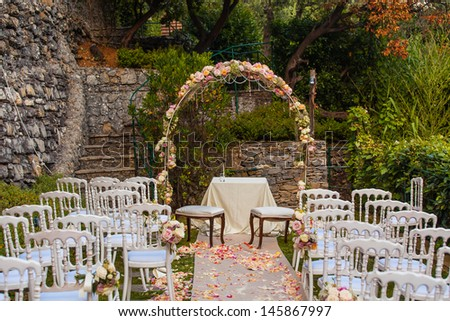 Wedding archway with flowers arranged for wedding ceremony - stock photo