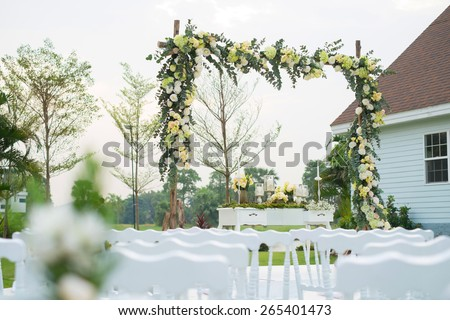 wedding backdrop on stage with blurry chair as foreground - stock photo