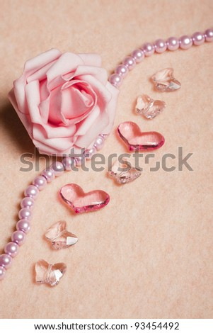 Wedding background with rose and  heart-shaped beads - stock photo