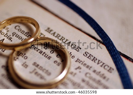 Wedding bands on bible before wedding ceremony. - stock photo