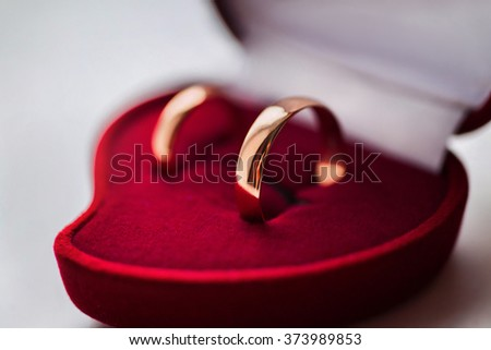 wedding bands, wedding rings in the red box, wedding jewelry, wedding preparation, wedding rings box - stock photo