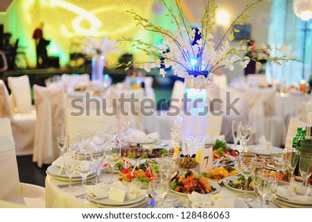 wedding banquet in a restaurant, served table - stock photo