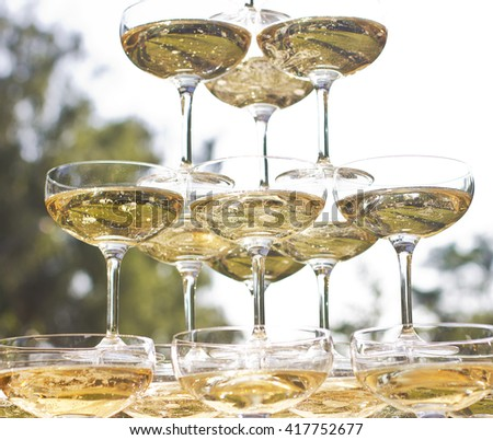 Wedding banquet outdoors. Wedding ceremony.Glasses of champagne. are poured champagne - stock photo