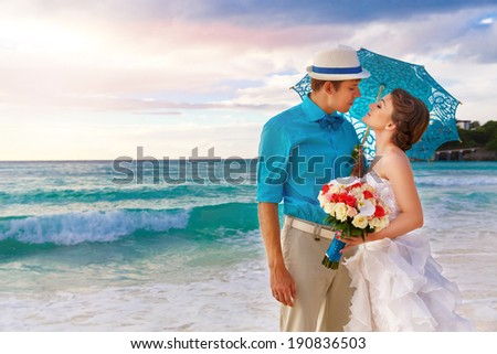 Wedding. Bbride and groom on the tropical coast at sunset - stock photo