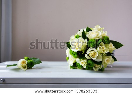 Wedding bouquet and boutonniere of white roses - stock photo
