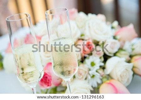 Wedding bouquet and champagne - stock photo