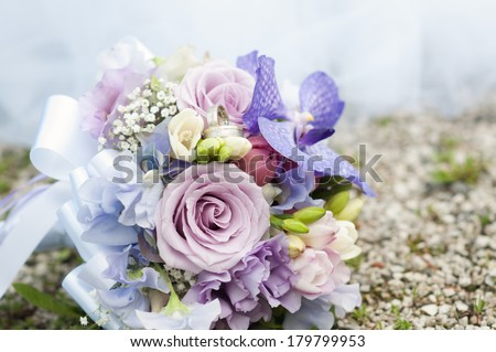 wedding bouquet and golden rings - stock photo