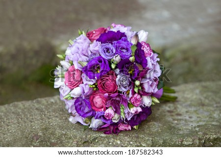 Wedding bouquet. Bouquet of colorful fresh flowers on natural background. Bridal bouquet. - stock photo