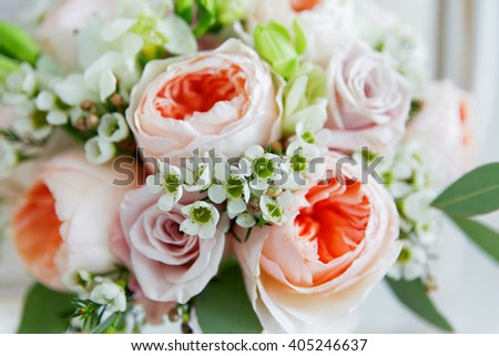 Wedding bouquet. Bride's traditional symbolic accessory. Floral composition with peonies and roses. - stock photo