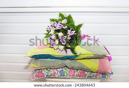 Wedding bouquet for bride on the pillows. - stock photo