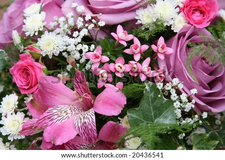 Wedding bouquet from lilac roses and lilies - stock photo