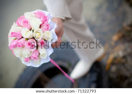 Wedding bouquet in a hand of the groom - stock photo
