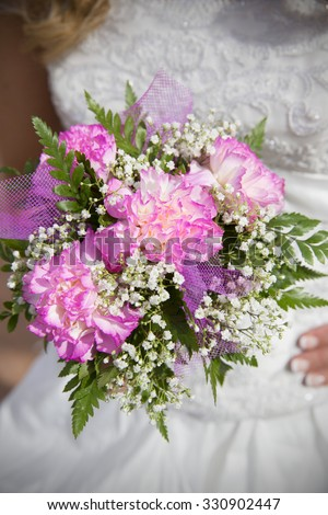 Wedding bouquet in hands of the bride - stock photo