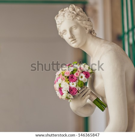wedding bouquet in the hands of the sculpture - stock photo