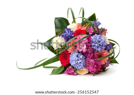 Wedding bouquet made of hyacinth, Rose, Gerber, Freesia and lilac flowers lying down on white background. - stock photo