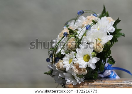 Wedding bouquet  of cream roses and chamomile - stock photo