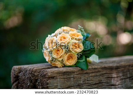 wedding bouquet of flowers on the bench - stock photo