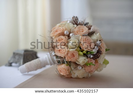 wedding bouquet of  pink and white roses with cones - stock photo