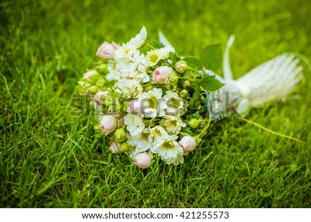 Wedding bouquet of  roses on green grass - stock photo