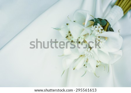 wedding bouquet of white calla lilies - stock photo