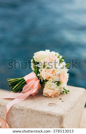 Wedding bouquet on a background of water - stock photo