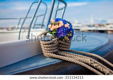 Wedding bouquet on a yacht - stock photo