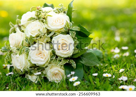 wedding bouquet on the green grass - stock photo