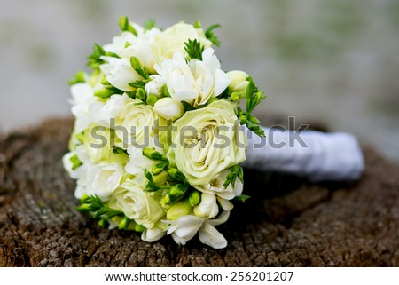 wedding bouquet on the stump - stock photo