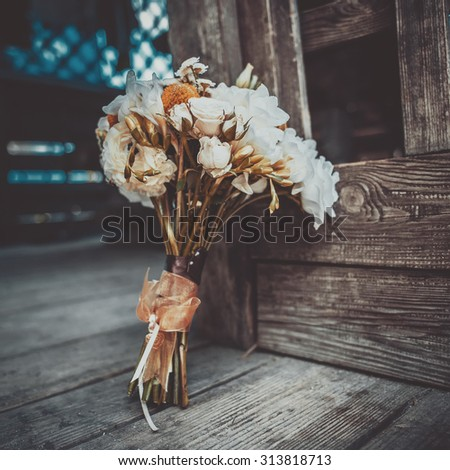 Wedding bouquet on wooden background. - stock photo