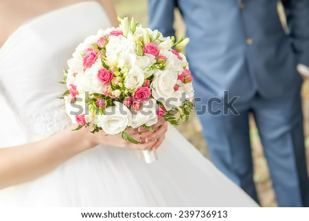 wedding bouquet. Wedding couple holding hands - stock photo