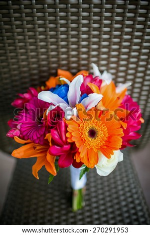Wedding bouquet with Gerbera Daisies, Roses, Asiatic lilies, Stargazer lilies, and Ginger - stock photo