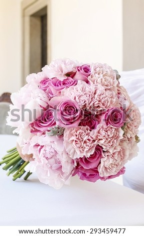 Wedding bouquet with pink peonies, carnations and roses - stock photo