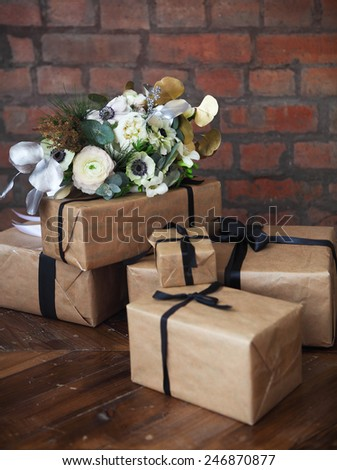 Wedding bouquet with ranunculus, freesia, roses and white anemon on the wedding presents - stock photo
