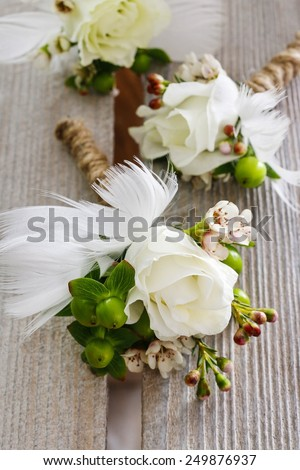 Wedding boutonniere made of eustoma flowers and hypericum plant - stock photo