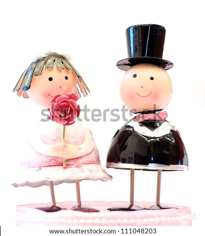 wedding bride and groom couple doll isolated on white - stock photo
