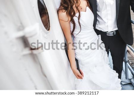 Wedding bride and groom on deck of boat, stylish couple. - stock photo