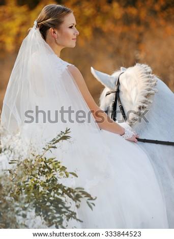 Wedding. Bride on white horse - stock photo