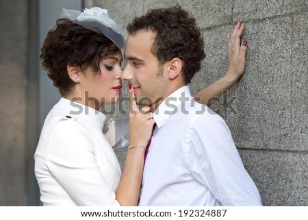 Wedding. Bride passionately presses the groom against the wall. - stock photo