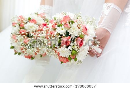 Wedding bunch of flowers in hands of the bride.  - stock photo