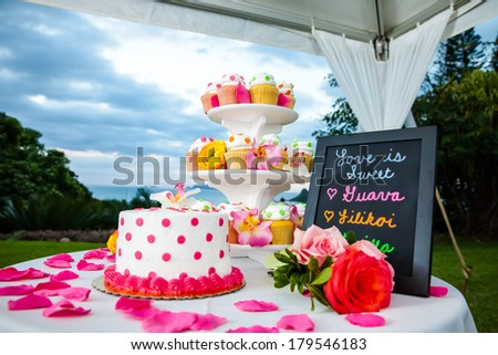 Wedding Cake and Cupcakes - stock photo