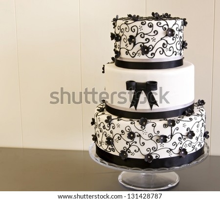 Wedding cake decorated with fondant - stock photo