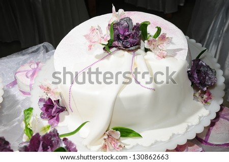 Wedding cake decorated with fresh flowers - stock photo